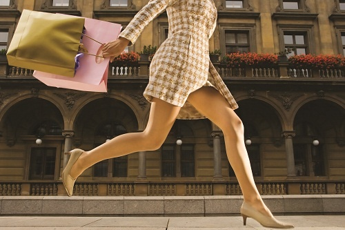 Woman Running in Square --- Image by © Randy Faris/Corbis