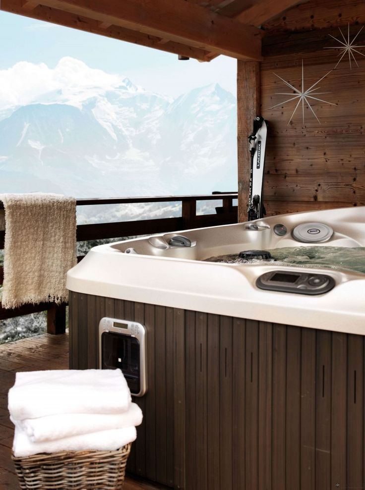 Wonderful mountain view Wooden railing Rattan basket Sophisticated bath tub