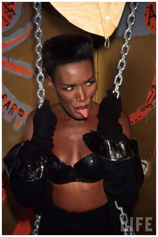 singer-grace-jones-sticking-her-tongue-out-1991