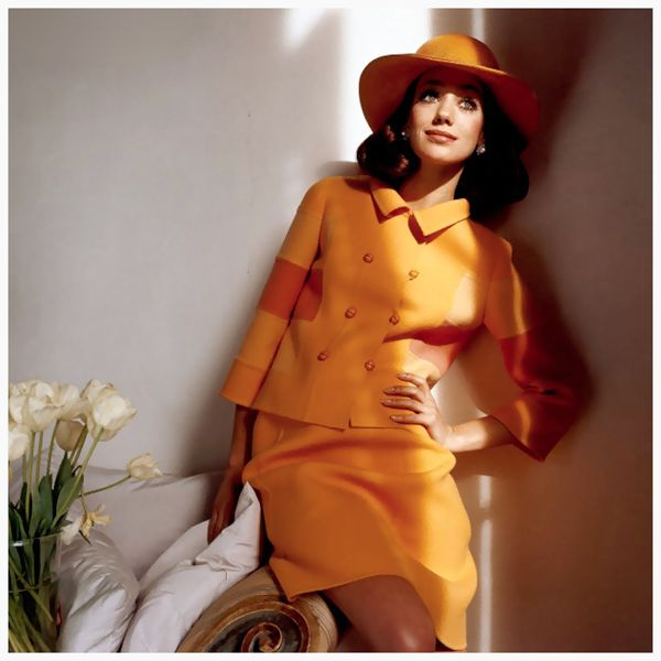 photo-henry-clarke-marisa-berenson-in-orange-model-marisa-berenson-wearing-an-orange-skirt-suit-with-a-double-breasted-jacket-featuring-color-blocked-sleeves-with-matching-wide-brim
