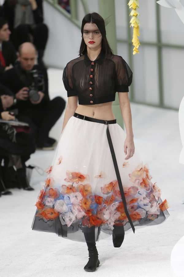 Kendall Jenner walks on runway wearing midriff-baring sheer blouse during the Chanel show as part of Paris Fashion Week Haute Couture Spring/Summer 2015