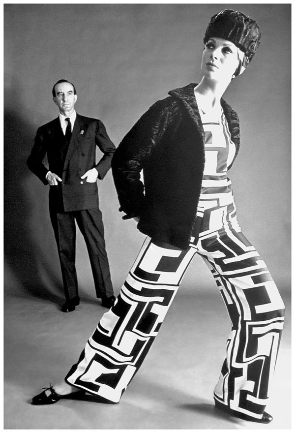 marquis-emilio-pucci-and-model-wearing-palazzo-pyjamas-in-printed-silk-in-the-torre-motif-with-jacket-and-hat-fall-winter-1966-collection